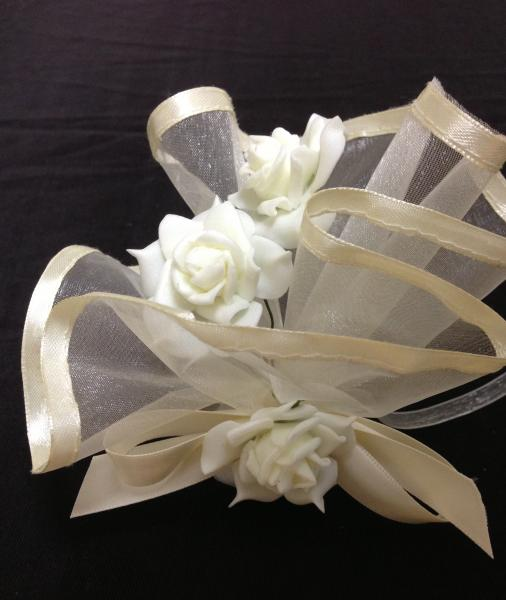 So many brides are doing cream this year. This party favor has a cascade of flowers.