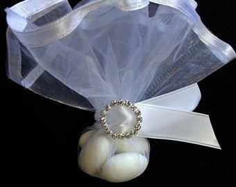 White organza with satin trim.  Rhinestone buckle.  5 Koufeta.  $3.75 each. Can handle any size order.