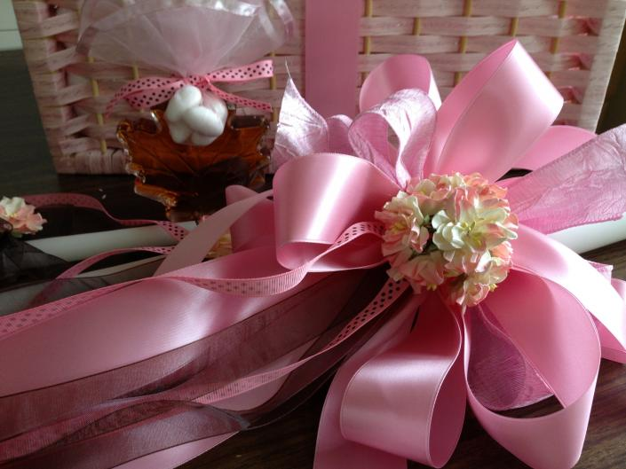 Pink Satin, Pink Shear, Pink and Brown Grosgrain ribbons. Two tone paper flowers.  