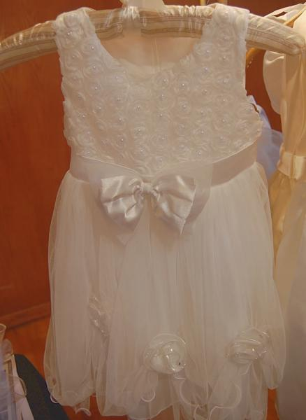 Many times the family waits a bit to baptize their baby girl.  We carry size 3T one of a kind dresses. 