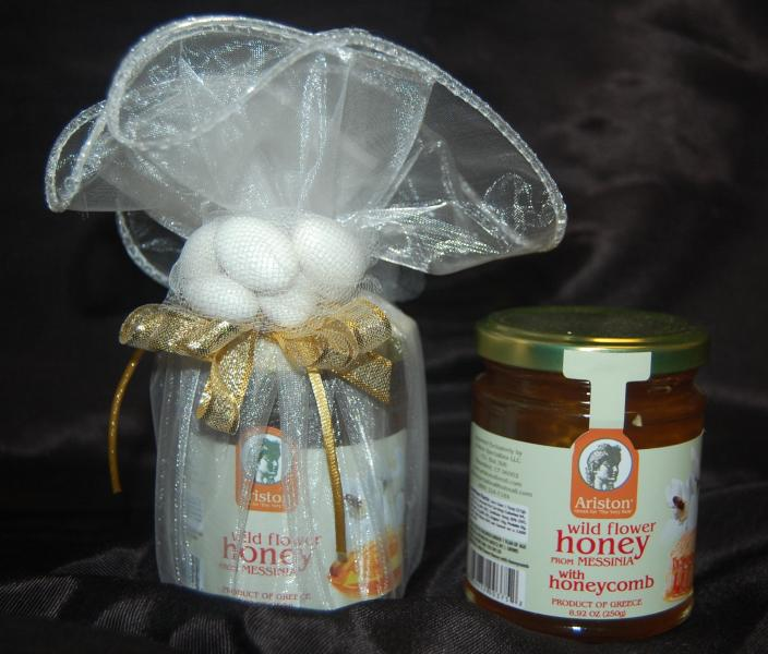 Greek honey jar wrapped in toule with jordan almonds.  A special gift for shower, wedding or baptism guests.  Honey imported from Greece.  $15 each.  May be personalized with ribbon.