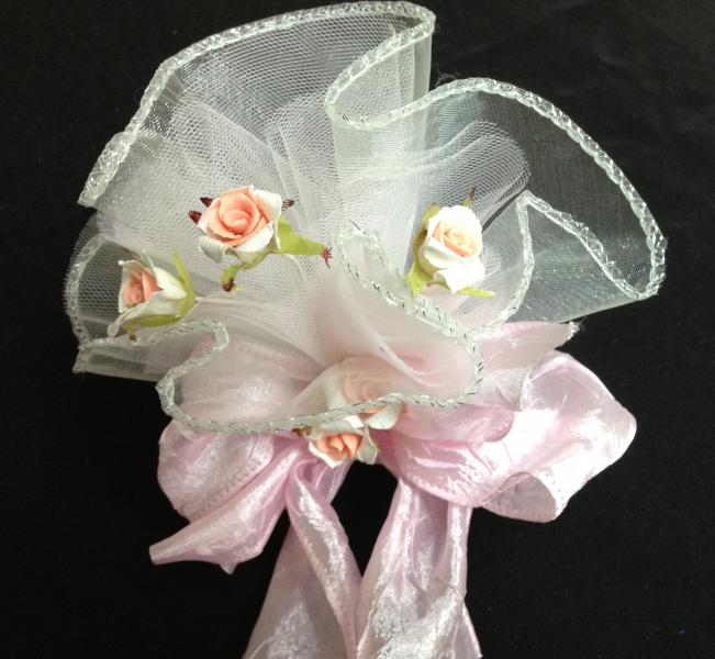 This party favor can go for a wedding or a baptism.  The bow is a standout that makes it pop.